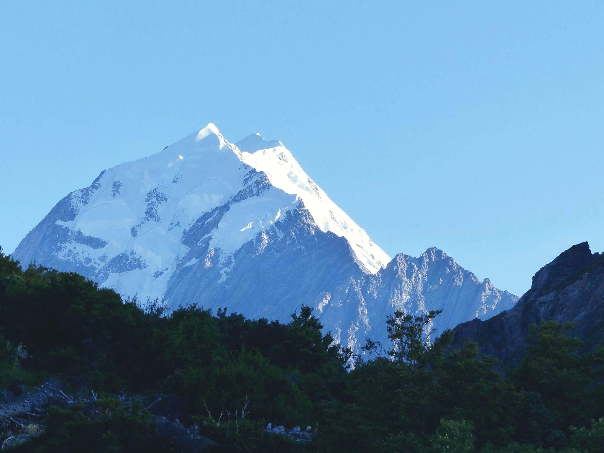 View the glory of snow capped mountains, bush and rivers.